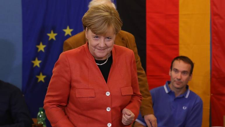 Chancellor Angela Merkel#39;s deal with social democrats opens way to new German government
