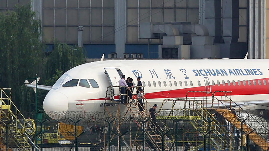 Co-pilot sucked halfway out of Sichuan Airlines' aircraft after cockpit window breaks at 32,000 feet over China