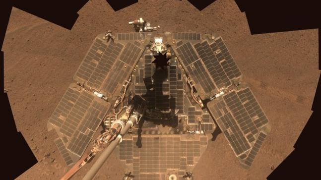 Martian dust storm puts Nasa's Opportunity rover into sleep mode